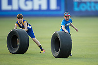 A couple of young fans compete in a tire race between innings of the South Atlantic League game between the Hickory Crawdads and the Kannapolis Intimidators at Kannapolis Intimidators Stadium on May 18, 2017 in Kannapolis, North Carolina.  The Crawdads defeated the Intimidators 6-4.  (Brian Westerholt/Four Seam Images)