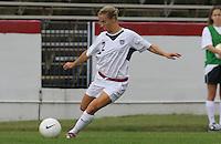 Heather Mitts kicks the ball. The USA defeated Iceland 2-1 at Univ. of Richmond Stadium in Richmond, Virginia on Sunday, October 8, 2006.