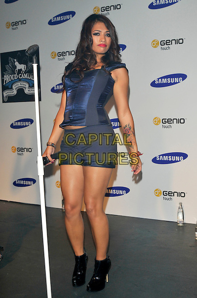 THE SATURDAYS - Vanessa White.Launch of the new mobile phone Samsung Genio Touch at Proud Camden, London, England..September 14th, 2009.stage concert live gig performance music full length blue corset top tattoo  ankle boots shorts  black.CAP/PL.©Phil Loftus/Capital Pictures.