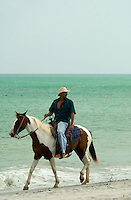 Panamanian man on horseback on beach, Playa Blanca, Panama