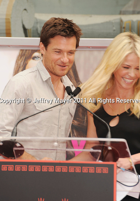 HOLLYWOOD, CA - JULY 07: Jason Bateman and Chelsea Handler attend Jennifer Aniston's Hand And Footprint Ceremony at Grauman's Chinese Theatre on July 7, 2011 in Hollywood, California.