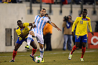 Ecuador midfielder Walter Ayovi (10) and Argentina midfielder Javier Mascherano (14) battle for the ball. Argentina and Ecuador played to a 0-0 tie during an international friendly at MetLife Stadium in East Rutherford, NJ, on November 15, 2013.