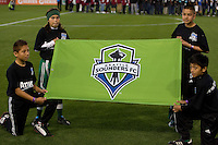 Kids holding Seattle Sounders banner before the game between Sounders and Earthquakes at Buck Shaw Stadium in Santa Clara, California on April 2nd, 2011.   San Jose Earthquakes and Seattle Sounders are tied 2-2.
