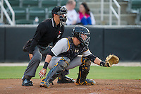West Virginia Power catcher Reese McGuire (24) frames a pitch as home plate umpire Jeff Gorman looks on during the South Atlantic League game against the Kannapolis Intimidators at CMC-Northeast Stadium on April 17, 2014 in Kannapolis, North Carolina.  The Power defeated the Intimidators 4-3.  (Brian Westerholt/Four Seam Images)