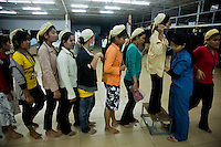 July 06, 2009 - Phnom Penh, Cambodia. Workers are searched before leaving for their lunch break in a garment factory. © Nicolas Axelrod / Ruom