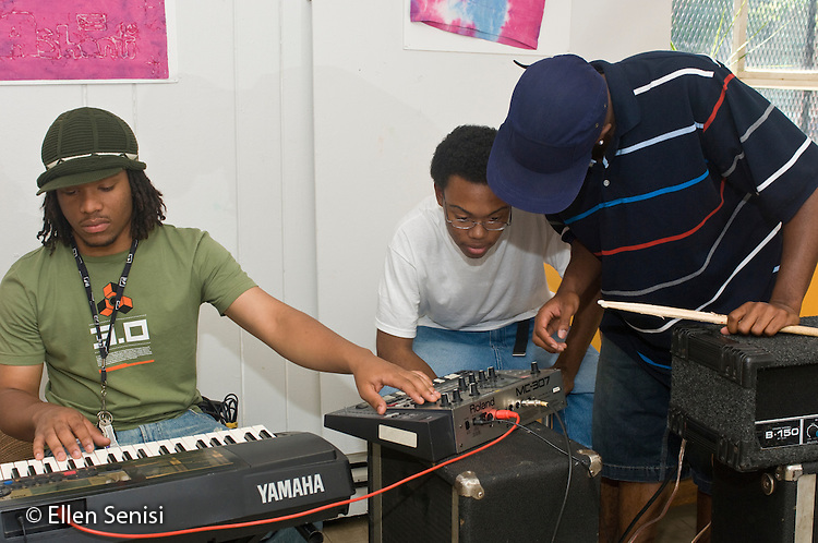 MR / Schenectady, New York. Three teenaged boys (all: 17, African-American) collaborate on writing original music together on electronic keyboard during a rehearsal. MR: Moj1, Wil26, Bro8 ID: AG-HSD ©Ellen B. Senisi