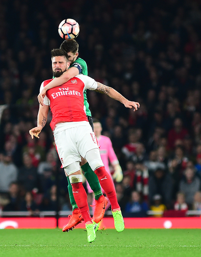 Lincoln City's Luke Waterfall vies for possession with Arsenal's Olivier Giroud<br /> <br /> Photographer Andrew Vaughan/CameraSport<br /> <br /> The Emirates FA Cup Quarter-Final - Arsenal v Lincoln City - Saturday 11th March 2017 - The Emirates - London<br />  <br /> World Copyright &copy; 2017 CameraSport. All rights reserved. 43 Linden Ave. Countesthorpe. Leicester. England. LE8 5PG - Tel: +44 (0) 116 277 4147 - admin@camerasport.com - www.camerasport.com
