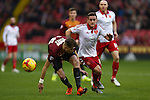 Sheffield United's Billy Sharp battles Reece Burke of Bradford - Sheffield United vs Bradford City - Skybet League One - Bramall Lane - Sheffield - 28/12/2015 Pic Philip Oldham/SportImage<br /> --------------------<br /> Sport Image<br /> 15/16 CONT Sheffield Utd v Bradford<br /> <br /> 28 December 2015<br /> ©2015 Sport Image all rights reserved