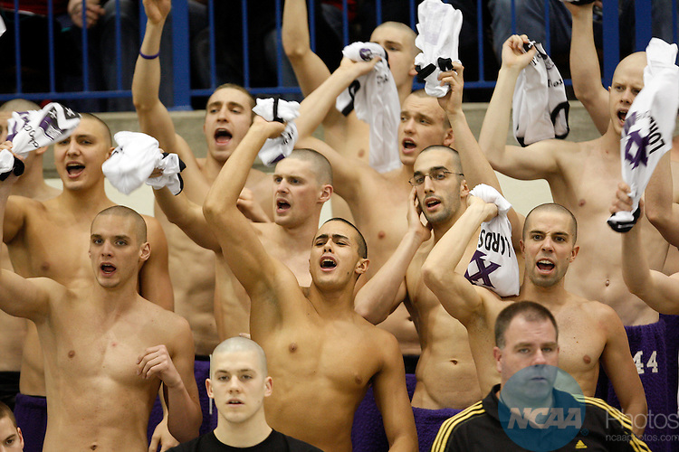 21 MAR 2009: Members of the Kenyon College men's swim team cheer on their teammates during the Division III Men's Swimming and Diving Championship held at the University Aquatic Center on the University of Minnesota campus in Minneapolis, MN. Carlos Gonzalez/NCAA Photos...