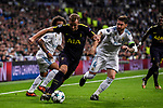 Harry Kane of Tottenham Hotspur FC (C) fights for the ball with Marcelo Vieira Da Silva of Real Madrid (L) and Sergio Ramos of Real Madrid (R) during the UEFA Champions League 2017-18 match between Real Madrid and Tottenham Hotspur FC at Estadio Santiago Bernabeu on 17 October 2017 in Madrid, Spain. Photo by Diego Gonzalez / Power Sport Images