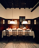 ITALY, Verona, Gargagnago di Valpolicella, vegetables on dining table under hanging illuminated lamps at the La Foresteria Serego Alighieri.