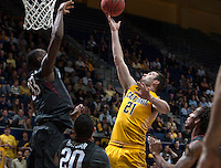 Jeff Powers of California shoots the ball during 2014 National Invitation Tournament against Arkansas at Haas Pavilion in Berkeley, California on March 24th, 2014.  California defeated Arkansas, 75-64.