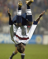 USA's Eddie Johnson celebrates with a back flip after scoring a goal in the first half to lead the USA to a 1-1 tie with Jamaica in the semifinal round of CONCACAF Qualifying for the 2006 FIFA World Cup, in Columbus, Ohio, Wednesday, Nov. 17, 2004.