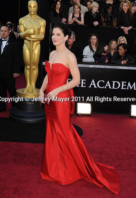 HOLLYWOOD, CA - FEBRUARY 27: Sandra Bullock arrive at the 83rd Annual Academy Awards held at the Kodak Theatre on February 27, 2011 in Hollywood, California.