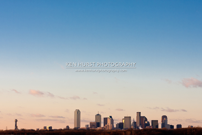 Wide angle view of the Dallas, Texas skyline from the south at the I-45 Interstate bridge over the Trinity River in late afternoon.