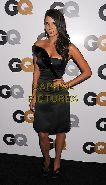 Genesis Rodriguez.Arriving at the GQ Men Of The Year Party at Chateau Marmont Hotel in Los Angeles, California, USA..November 13th, 2012.full length dress black one shoulder off the hand on hip.CAP/ROT/TM.©Tony Michaels/Roth Stock/Capital Pictures