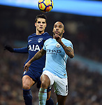 Fabian Delph of Manchester City is challenged by Erik Lamela of Tottenham Hotspur during the premier league match at the Etihad Stadium, Manchester. Picture date 16th December 2017. Picture credit should read: Robin ParkerSportimage
