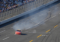 Apr 29, 2007; Talladega, AL, USA; Nascar Nextel Cup Series driver Jeff Gordon (24) does a burnout as fans throw bottles and cans at his car after winning the Aarons 499 at Talladega Superspeedway. Mandatory Credit: Mark J. Rebilas