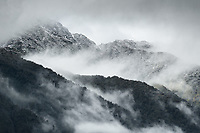 Swirling clouds over freshly snowed up lower  Southern Alps, Westland Tai Poutini National Park, West Coast, UNESCO Wolrd Heritage Area, New Zealand, NZ