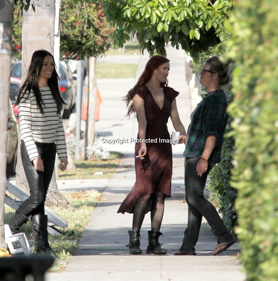 May 19th 2011   Exclusive...Rumer Willis laughing & dancing with co-workers outside of her movie trailer in Los Angeles. Rumer was filming her new movie called The Ganzfeld Experiment..Rumer was wearing a long red dress to match her hair with black army boots. It looks like rumer might have a little pregnant baby bump while smoking a cigarette ..AbilityFilms@yahoo.com.805-427-3519.www.AbilityFilms.com