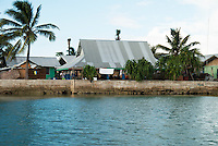 Sea walls in Majuro protect houses from the more placid waters of the lagoon.