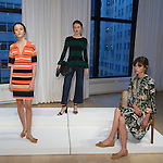 Models pose in outfits from the Ann Taylor Spring Summer 2017 collection by Austyn Zung, at the Ann Taylor showroom in 7 Times Square, New York on October 26, 2016.