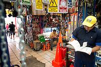 Raul Arturo Lara San Vincente (sentado) y Cristian Ivan Rodriguez Mendoza.  Hardware store owners in Mercado Hidalgo,  Mexico DF, Mexico