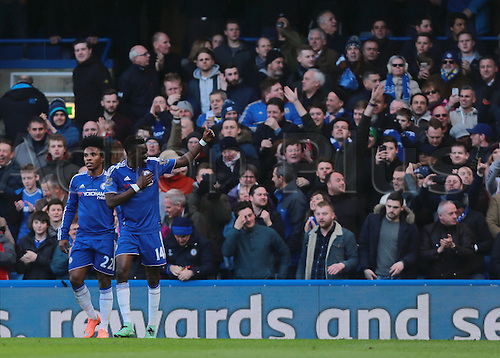 05.03.2016. Stamford Bridge, London, England. Barclays Premier League. Chelsea versus Stoke City. Chelsea Midfielder Bertrand Traoré (right) scores past Stoke City Goalkeeper Jack Butland, and celebrates with his fans, 1-0 Chelsea