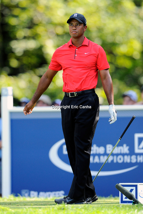 September 3, 2012 Tiger Woods of the United States drops his club on the 8th tee in reaction to his shot. Woods was competing in the  Championship round of the Deutsche Bank Championship tournament held at The Tournament Players Club, in Norton, Massachusetts.  Eric Canha/CSM