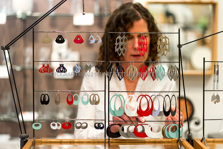 10/20/2014&mdash;Seattle, WA, USA<br /> <br /> Frances Smerch, owner of &lsquo;Click! Design That Fits&rsquo; in West Seattle. in the froegorund is her line of jewelry called &quot;Tattoo&quot;.<br /> <br /> 4540 California Ave SW Seattle WA 98116<br /> http://clickdesignthatfits.com<br /> <br /> Photograph by Stuart Isett<br /> &copy;2014 Stuart Isett. All rights reserved.