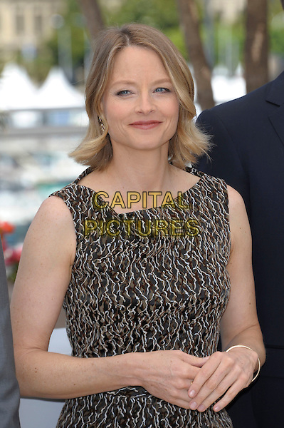 JODIE FOSTER.'The Beaver' photocall at the Palais des Festival, 64th International Cannes Film Festival, France.17th May 2011.half length dress brown beige print sleeveless .CAP/PL.©Phil Loftus/Capital Pictures.