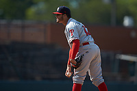 Lakewood BlueClaws relief pitcher Victor Santos (12) looks to his catcher for the sign against the Hickory Crawdads at L.P. Frans Stadium on April 28, 2019 in Hickory, North Carolina. The Crawdads defeated the BlueClaws 10-3. (Brian Westerholt/Four Seam Images)