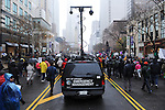 "Police set up a communications tower to monitor protests on Michigan Avenue, Chicago's ""Magnificent Mile"" and longest shopping street, three days after the release of a dash cam video documenting the killing of Laquan McDonald by Chicago Police Officer Jason Van Dyke, who has been charged with his murder, on Black Friday, the busiest shopping day of the year, in Chicago, Illinois on November 27, 2015.  Van Dyke fired 16 shots at McDonald and fired 13 of those shots after McDonald was on the ground and only stopped after his colleague told him to stand down; a journalist for outlet DNA Info sued the City of Chicago for release of the dash cam video, which the city released only after ordered to do so by a judge last week."