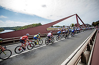 Peloton riding over the Maas river which devides Belgium from The Netherlands at this point. <br /> <br /> Binckbank Tour 2018 (UCI World Tour)<br /> Stage 6: Riemst (BE) - Sittard-Geleen (NL) 182,2km