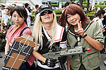 Cosplayers pose for a picture during the ''Comic Market 88 Summer 2015'' exhibition at Tokyo Big Sight on August 14, 2015, Tokyo, Japan. Thousands of manga and anime fans attended the first day of the Comic Market 88 (Comiket) at Tokyo Big Sight. The Comic Market was established in 1975 to allow fans and artists to interact and focuses on manga, anime, gaming and cosplay. The exhibition is held from August 14th to 16th and Comiket organisers expect more than 500,000 visitors to attend. (Photo by Rodrigo Reyes Marin/AFLO)