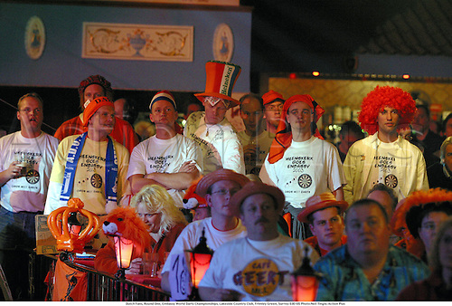 Dutch Fans, Round One, Embassy World Darts Championships, Lakeside Country Club, Frimley Green, Surrey 030105 Photo:Neil Tingle/Action Plus...2003.man dart crowds spectators fans