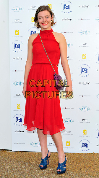 Camilla Rutherford.Attends Chucs Dive & Mountain Shop Swim Party in aid of charity: water at The Serpentine, London, England..July 4th, 2011.full length dress shoes red lipstick smiling pink sleeveless top purple bag purse blue shoes peep toe.CAP/CJ.©Chris Joseph/Capital Pictures.
