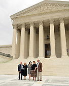 Washington, DC - September 8, 2009 -- Associate Supreme Court Justice Sonia Sotomayor and her family pose for photographers following the investiture ceremony in her honor at the United States Supreme Court in Washington, D.C. on Tuesday, September 8, 2009.  From left to right: Mr. Omar Lopez, Stepfather; Mrs. Celina Sotomayor, Mother; Mrs. Tracey Sotomayor, Sister-in-law; and Dr. Juan Sotomayor, Brother..Credit: Ron Sachs / CNP