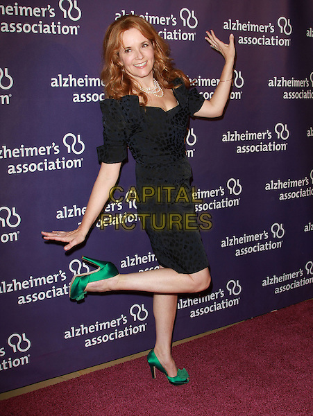 "LEA THOMPSON .19th Annual ""A Night at Sardi's"" Benefiting the Alzheimer's Association held at the Beverly Hilton Hotel, Beverly Hills, California, USA, 16th March 2011..full length  dress green peep toe shoes  black pearl necklace pearls hands gesture standing on one foot leg .CAP/ADM/KB.©Kevan Brooks/AdMedia/Capital Pictures."