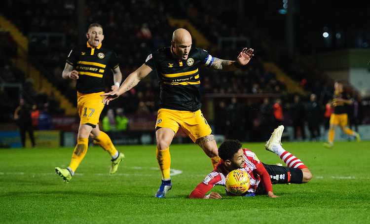 Lincoln City's Bruno Andrade vies for possession with Newport County's David Pipe<br /> <br /> Photographer Chris Vaughan/CameraSport<br /> <br /> The EFL Sky Bet League Two - Lincoln City v Newport County - Saturday 22nd December 201 - Sincil Bank - Lincoln<br /> <br /> World Copyright © 2018 CameraSport. All rights reserved. 43 Linden Ave. Countesthorpe. Leicester. England. LE8 5PG - Tel: +44 (0) 116 277 4147 - admin@camerasport.com - www.camerasport.com