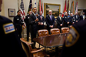 President Barack Obama and Vice President Joe Biden meet with members of the National Association of Police Organizations and TOP COP honorees in the Roosevelt Room of the White House, May 12, 2011..Mandatory Credit: Pete Souza - White House via CNP
