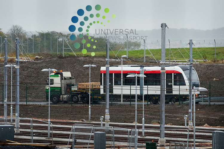 The first of twenty seven trams for Edinburgh arrives at the Gogar Depot, in three sections, Edinburgh, Scotland, 17th October, 2011.Picture:Scott Taylor Universal News And Sport (Europe) .All pictures must be credited to www.universalnewsandsport.com. (Office)0844 884 51 22.