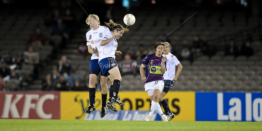 MELBOURNE, AUSTRALIA - OCTOBER 03: Vedrana POPOVIC and Maika RUYTER-HOOLEY from Melbourne Victory contest for the ball in round 1 of the Westfield W-league match between Melbourne Victory and Perth Glory at Etihad Stadium on 3 October 2009 in Melbourne, Australia. (Photo by Sydney Low http://syd-low.com)