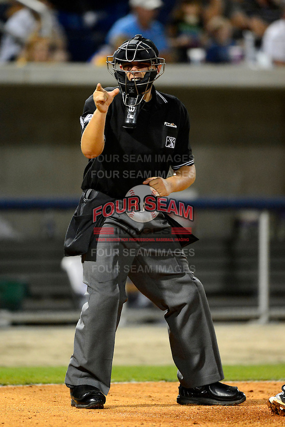 Umpire John Bostwick makes a call during a game between the Pensacola Blue Wahoos and Jacksonville Suns on April 15, 2013 at Pensacola Bayfront Stadium in Pensacola, Florida.  Jacksonville defeated Pensacola 1-0 in 11 innings.  (Mike Janes/Four Seam Images)