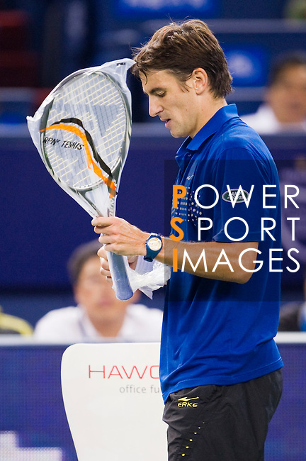 SHANGHAI, CHINA - OCTOBER 12:  Tommy Robredo of Spain changes his racquet during his match against Tomas Berdych of Czech Republic during day two of the 2010 Shanghai Rolex Masters at the Shanghai Qi Zhong Tennis Center on October 12, 2010 in Shanghai, China.  (Photo by Victor Fraile/The Power of Sport Images) *** Local Caption *** Tommy Robredo