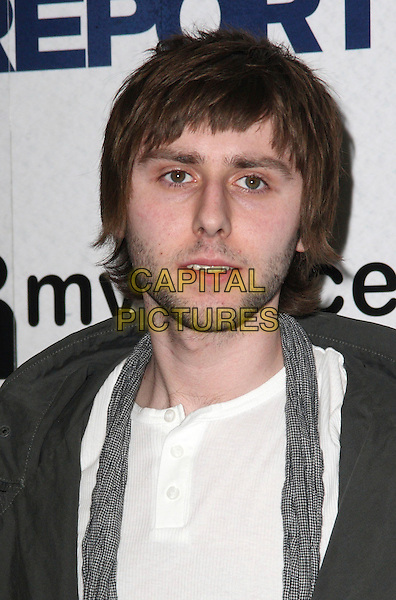 "JAMES BUCKLEY .""Observe and Report"" VIP Gala Screening at Vue Cinema, Islington, London  April 22nd 2009.portrait headshot beard facial hair stubble grey gray scarf white t-shirt buttons .CAP/JIL.©Jill Mayhew/Capital Pictures"