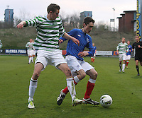 Ryan Hardie shields the ball from Fiacre Kelleher in the Celtic v Rangers City of Glasgow Cup Final match played at Firhill Stadium, Glasgow on 29.4.13,  organised by the Glasgow Football Association and sponsored by City Refrigeration Holdings Ltd..