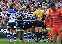 The Bath front row are congratulated by their fellow forwards after a big scrum. Aviva Premiership match, between Bath Rugby and Leicester Tigers on September 20, 2014 at the Recreation Ground in Bath, England. Photo by: Patrick Khachfe / Onside Images