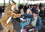 Willy Wildcat gives high-fives to Sue and Frank Jones before the start of the Western Nevada College commencement at the Pony Express Pavilion, in Carson City, Nev., on Monday, May 19, 2014. <br /> Photo by Cathleen Allison/Nevada Photo Source