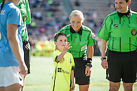 Seattle, WA - Sunday, April 17, 2016: A young Seattle Reign FC fan joins in on the coin toss prior to the match. Sky Blue FC defeated the Seattle Reign FC 2-1 during a National Women's Soccer League (NWSL) match at Memorial Stadium.